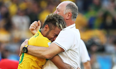 A crying Neymar is comforted by manager Luiz Felipe Scolari after Brazil beat Chile in the World Cup
