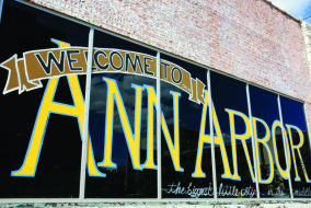 Michigan, Ann Arbor, Huron Street, painted sign, window, welcome,